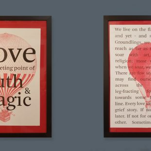 Two prints on the wall with red hot air balloons and text.