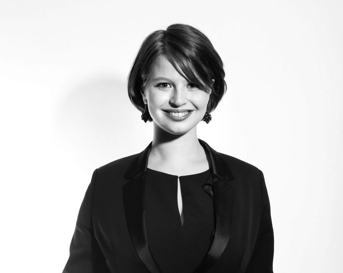 Black and white headshot of Emily Hoffman.