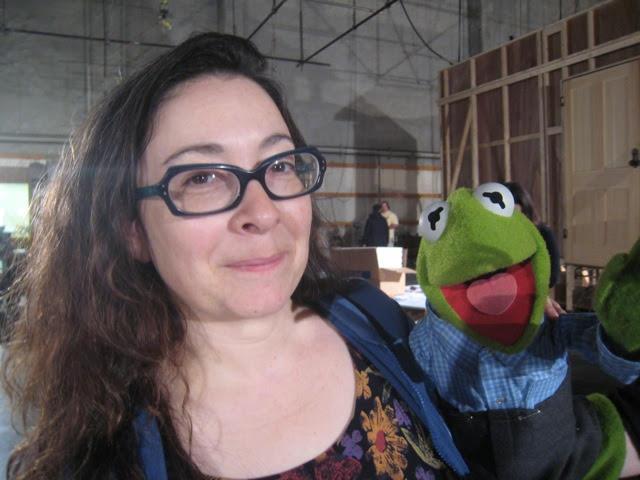 Headshot of Carol Silverman with a Kermit puppet.