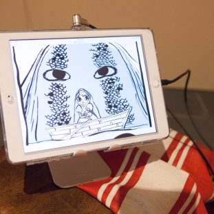 Ipad showing an ink illustration.