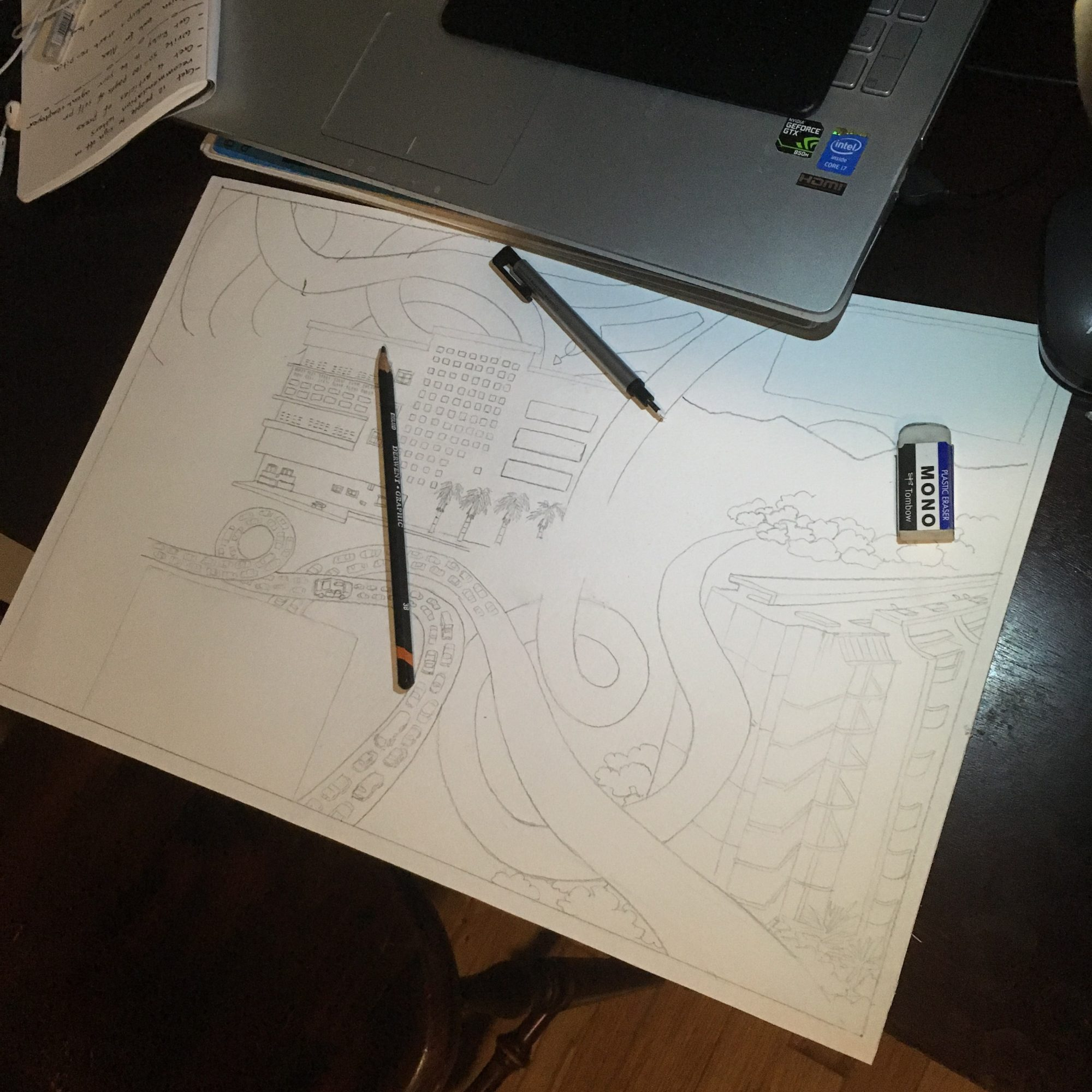 Photograph of an in progress drawing of a city.