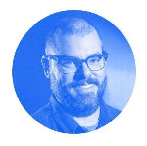 Blue monochromatic headshot of Nathan Fox.