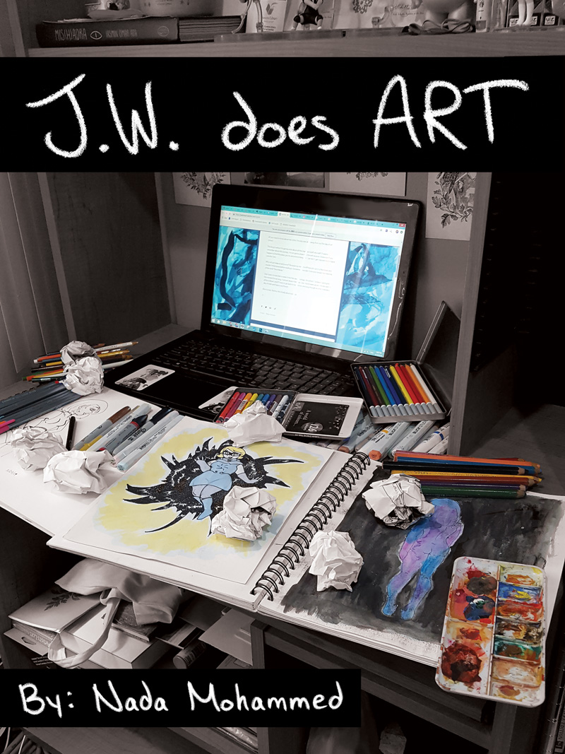 Photograph of a desk with an open sketchbook, a laptop and various art making tools surround it .