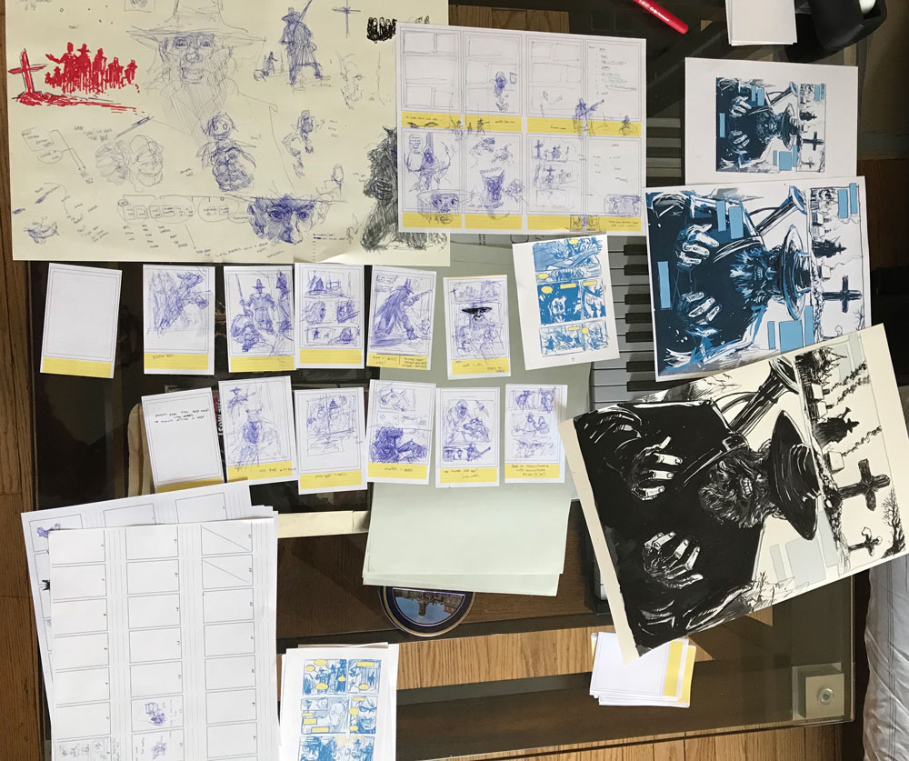 Photograph of a spread of sketches and thumbnails for a comic book.
