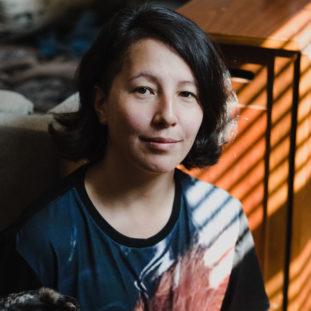 Headshot of Andrea Tsurumi.
