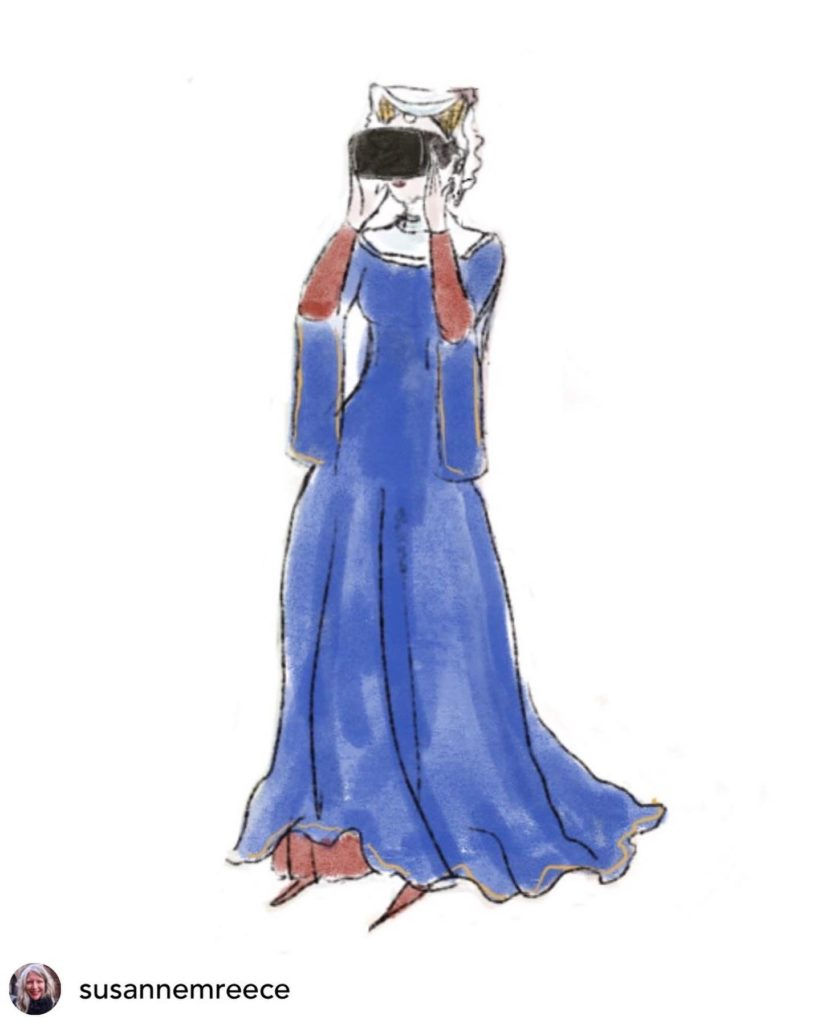 A woman in a European medieval blue dress holds a black virtual reality headset to her eyes.