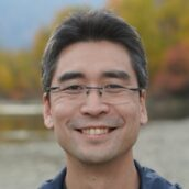 Bio pic of a smiling Kazu Kibuishi