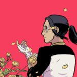 A woman with ling black hair in a ponytail sits among floating flower petals looking offscreen thoughtfully and with determination